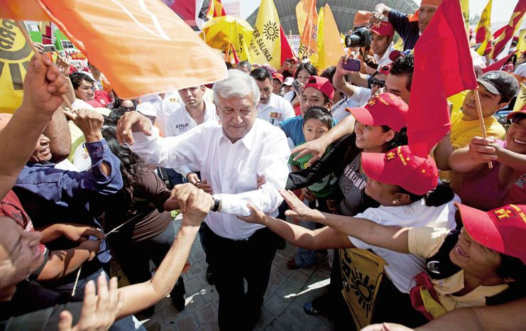 Andres Manuel Lopez Obrador greets supporters at a campaign rally in Cuautitlan Izcalli, Mexico, on June 6. A new poll shows his support in the presidential election rising, although he remains well behind front-runner Enrique Pena Nieto, a centrist. Mr. Lopez Obrador is a leftist. (Associated Press)