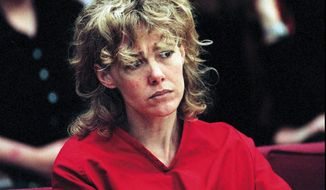 **FILE** Mary Kay Letourneau listens to testimony during a  court hearing on Feb. 6, 1998. Letourneau, 42, a former sixth-grade teacher, was freed from prison in 2004 after serving a seven-year term for child rape stemming from her relationship with Vili Fualaau, who was one of her students at the time and who fathered two children with Letourneau. (Associated Press)