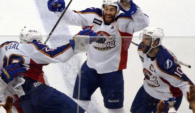 Norfolk Admirals' Brandon Segal, left, celebrates his goal against Toronto Marlies with teammates Philip-Michael Devos, center, and Mike Angelidis, right, in the third period of Game 2 of their AHL Calder Cup hockey finals, Saturday, June, 2, 2012, in Norfolk, Va. (AP Photo/The Virginian-Pilot, L. Todd Spencer)