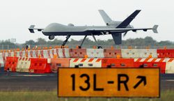 A Predator B unmanned aircraft lands after a mission in Texas in November. U.S. Customs and Border Protection uses the unmanned aircraft outfitted with powerful infrared cameras and sensitive radar to patrol U.S. borders. (Associated Press)