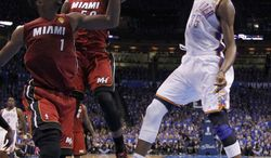 Oklahoma City Thunder small forward Kevin Durant dunks as Miami Heat power forward Chris Bosh and center Joel Anthony look on during Game 1 of the NBA finals Tuesday, June 12, 2012, in Oklahoma City. (AP Photo/Jim Young, Pool)