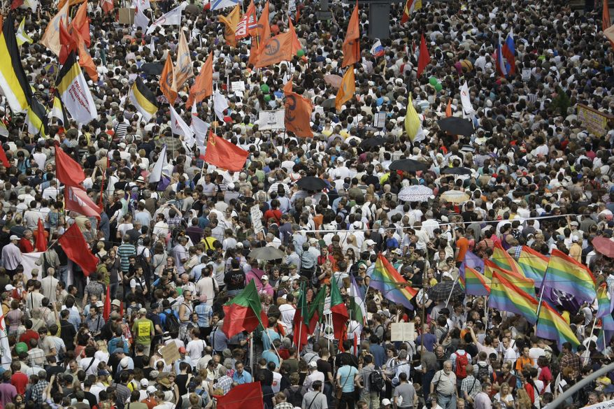 Demonstrators protest the rule of Russian President Vladimir Putin in Moscow on Tuesday, June 12, 2012. (AP Photo/Mikhail Metzel)