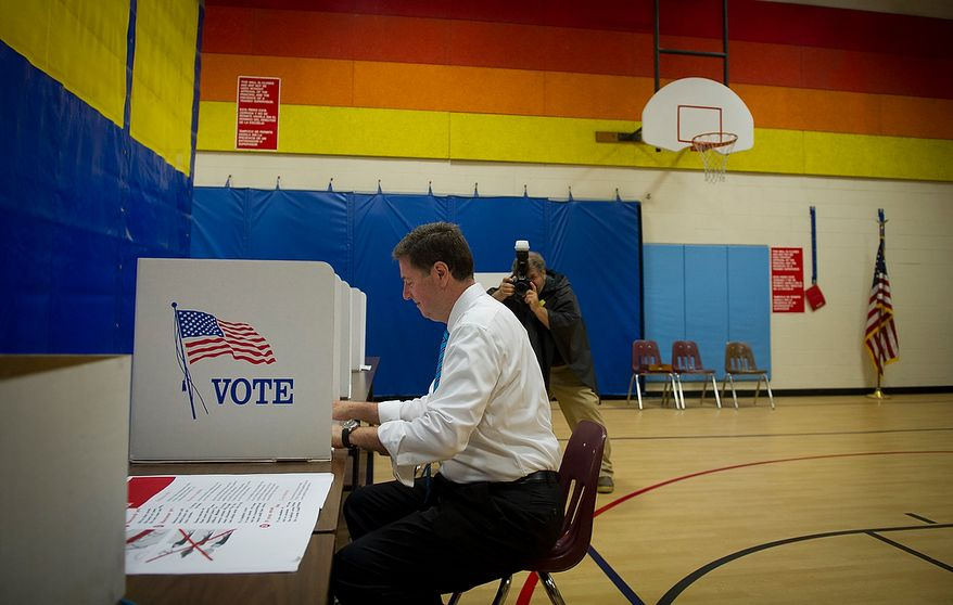 George Allen, a former Virginia governor and U.S. senator, casts his vote in the Republican primary at the Washington Mill Elementary School in Alexandria on Tuesday, June 12, 2012. (Rod Lamkey Jr./The Washington Times)