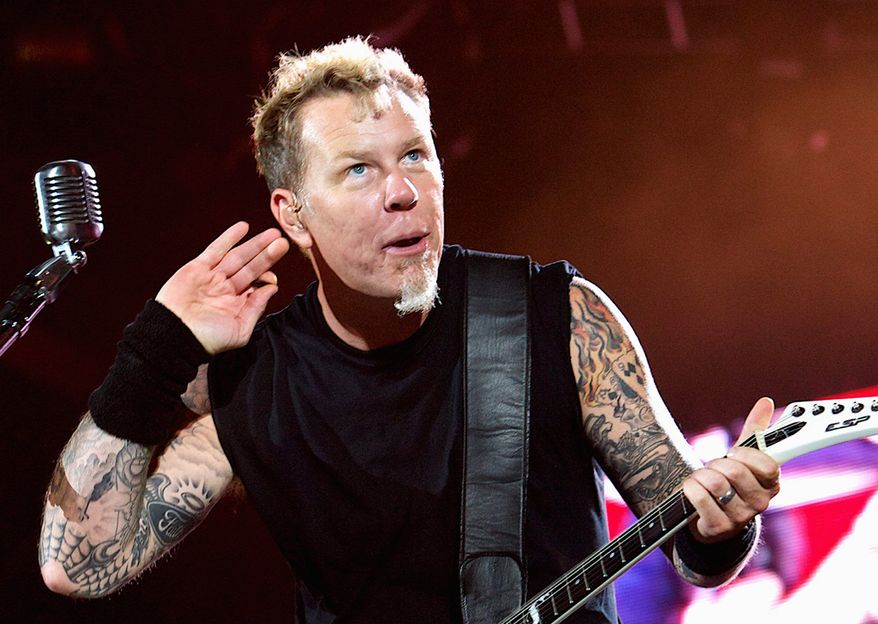 FILE - In this Oct. 25, 2011 file photo, Metallica's singer James Hetfield performs on Yas Island, Abu Dhabi, United Arab Emirates. The band Metallica is participating in a publicity campaign aimed at catching a man wanted in the death of a Virginia Tech student who disappeared after one of their concerts. (AP Photo/Nousha Salimi, File )
