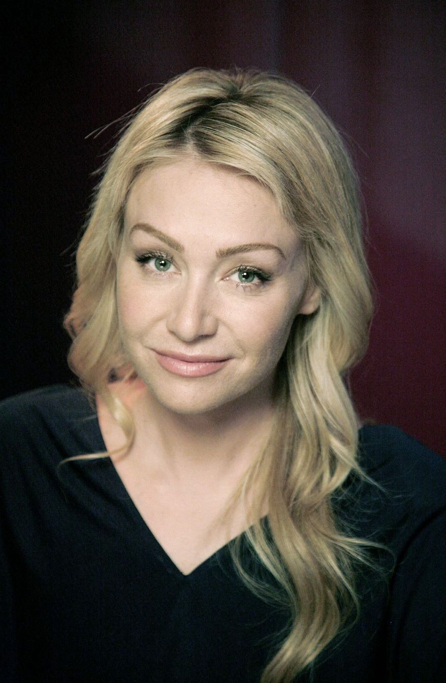 Actress Portia de Rossi poses for a portrait Wednesday, Nov. 3, 2010 in New York. (AP Photo/Jeff Christensen)