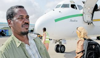 """Abdikhafar Abubakar prepares to board a plane for his return to Minneapolis after visiting his mother in Mogadishu for the first time in decades. """"When I was out walking around, I wasn't scared,"""" he said."""