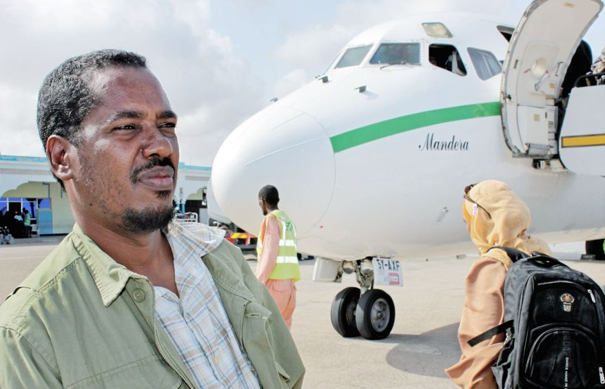 "Abdikhafar Abubakar prepares to board a plane for his return to Minneapolis after visiting his mother in Mogadishu for the first time in decades. ""When I was out walking around, I wasn't scared,"" he said."