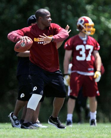 Washington Redskins new assistant coach Raheem Morris throws the ball during NFL football practice at Redskins Park in Ashburn, Va., Wednesday, June 13, 2012. (AP Photo/Pablo Martinez Monsivais)