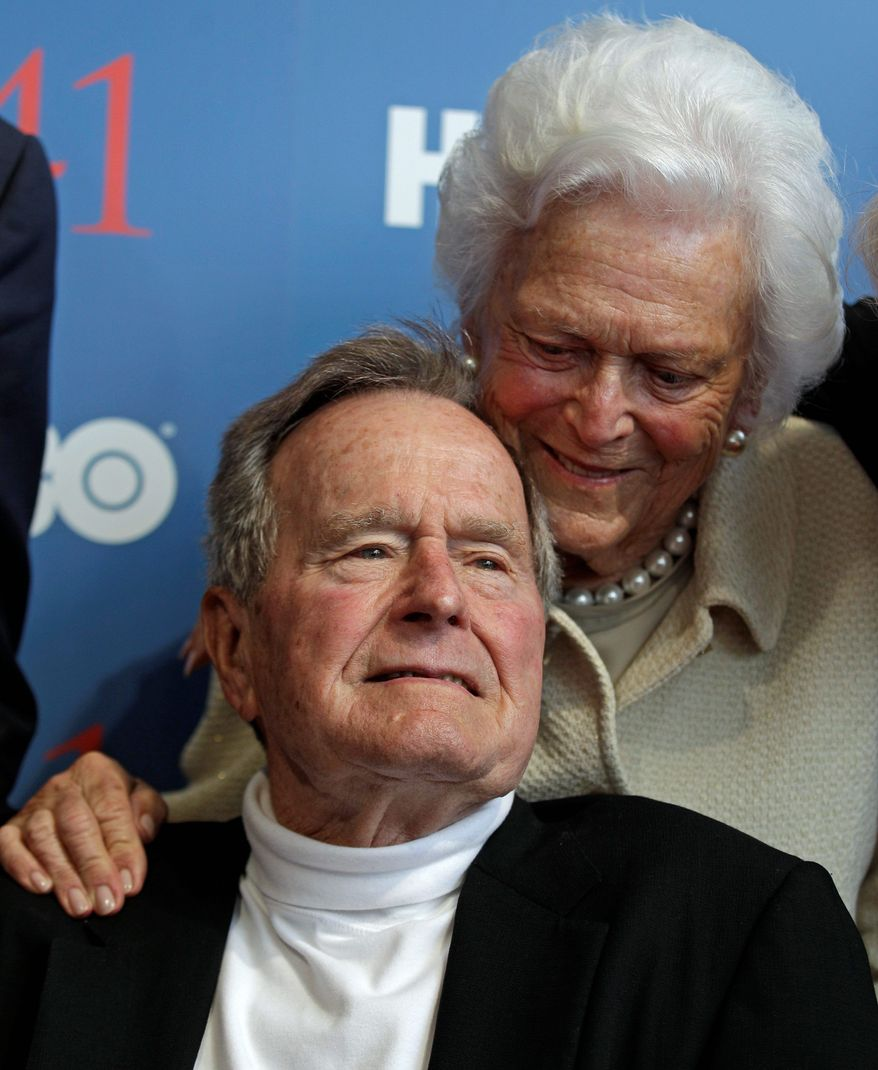 """**FILE** Former President George H.W. Bush and wife Barbara arrive for the premiere of HBO's new documentary about his life, """"41,"""" near the Bush family's summer home in Kennebunkport, Maine, on June 12, 2012, Mr. Bush's 88th birthday. (Associated Press)"""
