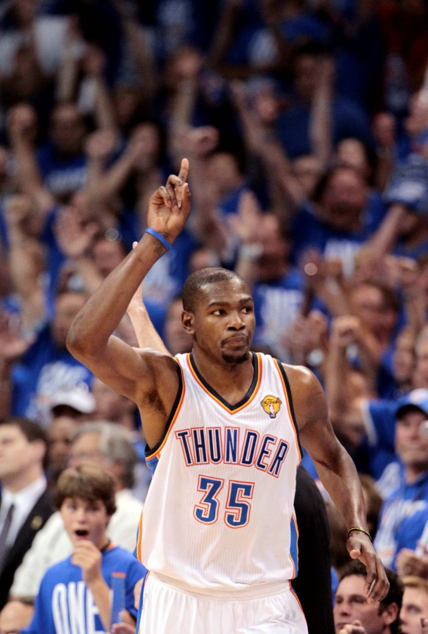 ASSOCIATED PRESS Oklahoma City forward Kevin Durant rang up 36 points in a 105-94 win over Miami in Game 1 of the NBA Finals .