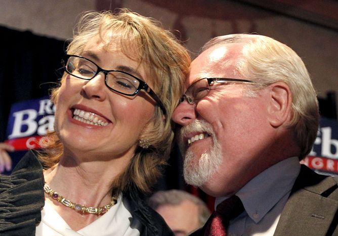 Former Rep. Gabrielle Giffords and Democratic congressional candidate Ron Barber celebrate Mr. Barber's victory in a special election on Tuesday, June 12, 2012, in Tucson, Ariz., to fill the vacant House seat that Mrs. Giffords held. (AP Photo/Ross D. Franklin, Pool)
