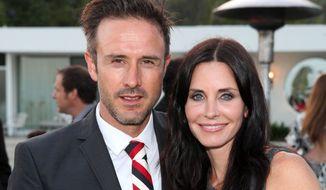 **FILE** David Arquette and Courtney Cox attend the Beau Joie Champagne Art of Elysium Dinner hosted by Rachel Bilson at Arquette's home in Beverly Hills, Calif., on June 28, 2011. (Associated Press/InStyle)