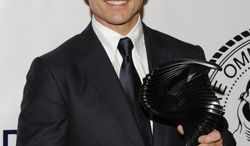Actor Tom Cruise poses June 12, 2012, after being honored by the Friars Club and Friars Foundation at the Waldorf-Astoria in New York. (Associated Press/Invision)