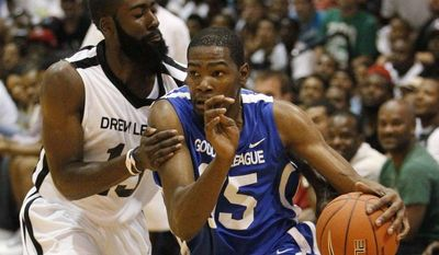 Oklahoma City Thunder's Kevin Durant, playing for Goodman League during the summer, drives on Thunder teammate James Harden, playing for Drew League, during the All-Star game at Trinity University in Washington. The Goodman League's success during the lockout has aided it now. (AP Photo/Charles Dharapak)