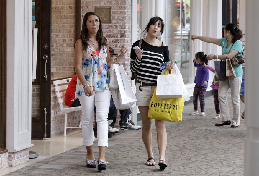 Shoppers walk through the South Shore Mall in Braintree, Mass., on Wednesday, May 30, 2012. Retail sales in the United States declined in April and May, pulled down by a sharp drop in gas prices. (AP Photo/Stephan Savoia)