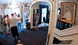 Tourists arrive through the front door of Graceland, Elvis Presley's home in Memphis, Tenn. (Associated Press)
