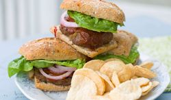 Healthy caramelized onions add moisture and flavor to lean beef. Topped with a delicious homemade barbecue sauce, these grilled burgers will be a real Father's Day treat that is healthy to boot. (Associated Press)