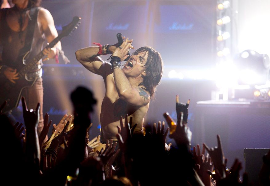 """Tom Cruise stars as Stacee Jaxx, a kind of Bon Jovi-Axl Rose hybrid, in the rock musical """"Rock of Ages."""" (Warner Bros. Pictures)"""