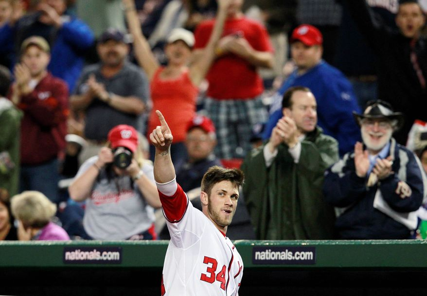 In 41 games, rookie outfielder Bryce Harper is hitting .303 with seven home runs and 19 RBIs as the Nationals have surged to the top of the NL East going into this weekend's showdown with the New York Yankees. (Associated Press)