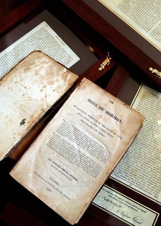 An 1830 first-edition Book of Mormon and a selection of framed individual pages owned by retired bookstore owner Helen Spencer Schlie are displayed i