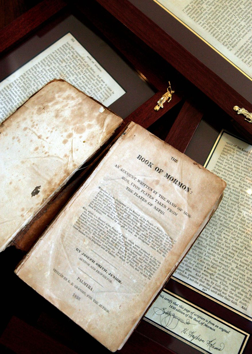 An 1830 first-edition Book of Mormon and a selection of framed individual pages owned by retired bookstore owner Helen Spencer Schlie are displayed in her Arizona home in this 2005 photo. (Associated Press)