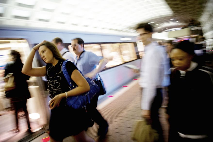 Rush-hour riders hurry to catch a morning train at the Pentagon Metro station. With the start of Rush Plus, some riders will see lines servicing their station that usually don't run there. Some Yellow Line trains will run from Franconia-Springfield to Greenbelt. (Rod Lamkey Jr./The Washington Times)