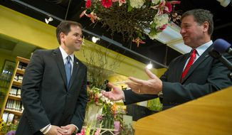 Sen. Marco Rubio (left), Florida Republican, endorses Virginia Republican George Allen (right) for the U.S. Senate at a press conference at Company Flowers, a family-owned small business, in Arlington on Thursday, June 14, 2012. (Andrew Harnik/The Washington Times)