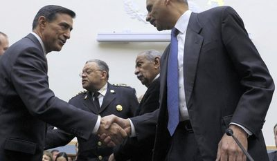 **FILE** House Judiciary Committee member Rep. Darryl Issa (left), California Republican, shakes hands Dec. 8, 2011, with Attorney General Eric Holder on Capitol Hill in Washington. (Associated Press)