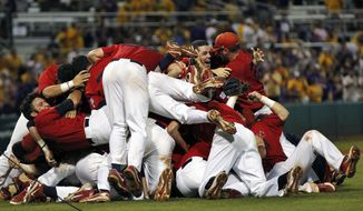 Stony Brook celebrates after defeating LSU 7-2 in Game 3 of an NCAA tournament super regional game in Baton Rouge, La., on Sunday, June 10, 2012. Stony Brook advanced to the College World Series with the win. (AP Photo/Gerald Herbert)
