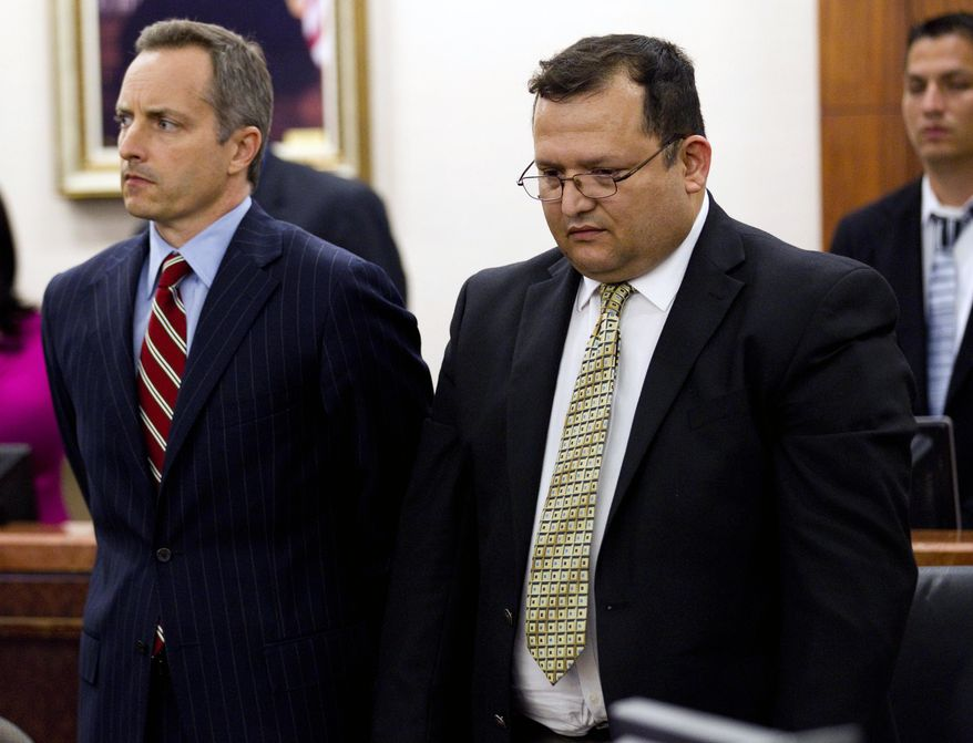 Raul Rodriguez (right) stands with his attorney Bill Stradley in a Houston courtroom on Wednesday, June 13, 2012, as he is found guilty of killing a neighbor two years ago. (AP Photo/Houston Chronicle, Brett Coomer)