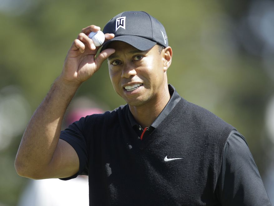 Tiger Woods reacts after making a birdie on the 10th hole during the second round of the U.S. Open Championship on Friday, June 15, 2012, at The Olympic Club in San Francisco. (AP Photo/Ben Margot)