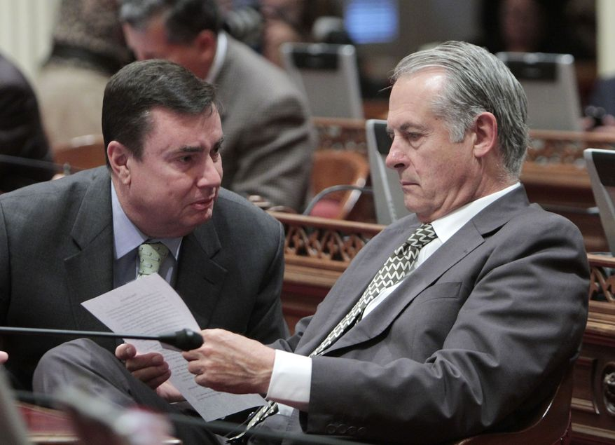 Republican state Sens. Joel Anderson (left), of La Mesa, and Bill Emerson, of Redlands, confer June 14, 2012, during the Senate session at the Capitol in Sacramento, Calif. (Associated Press)