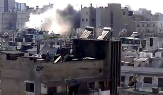 This image made from amateur video released by Shaam News Network and accessed June 14, 2012, purports to show shelling in Joret el-Shayah, Homs, Syria. (Associated Press/Shaam News Network via AP video)