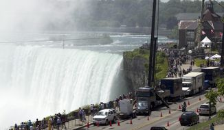Spectators and press gather June 15, 2012, to see the 550-meter tightrope stretching across Niagara Falls in Niagara Falls, Ontario, Canada. Nik Wallenda was expected later that evening to attempt to walk the length of the rope. (Associated Press/The Canadian Press)