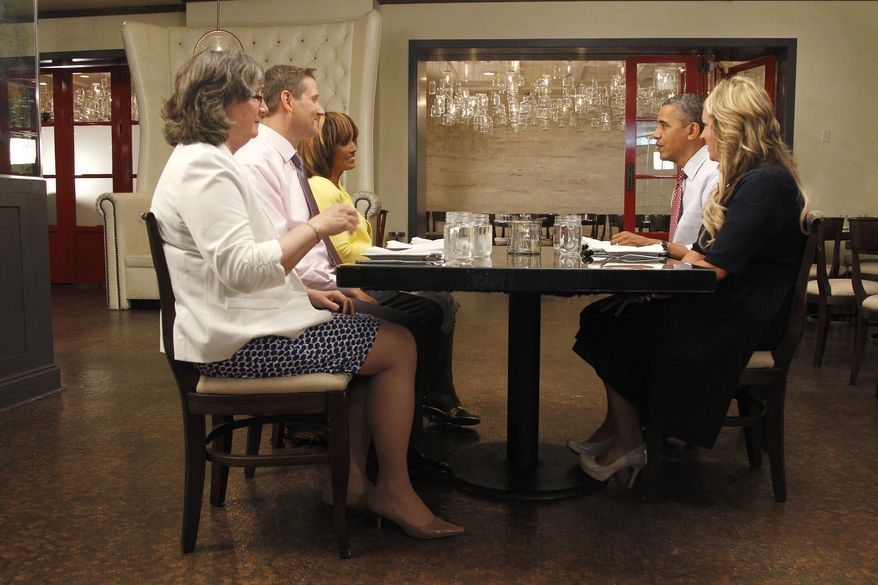 """President Obama eats lunch June 15, 2012, with Wyndi Austin, Paula Matyas, Jim Heath and Janet Jones, the four winners of the """"Lunch with Barack"""" raffle, at the Lincoln Restaurant in Washington. (Associated Press)"""