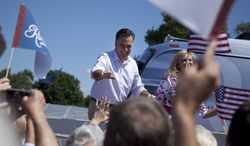 Republican presidential candidate and former Massachusetts Gov. Mitt Romney and his wife, Ann, arrive June 15, 2012, for a campaign stop at the Scamman Farm in Stratham, N.H. (Associated Press)