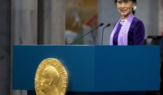 "Aung San Suu Kyi delivers a speech during the Nobel ceremony at Oslo's City Hall, Norway, June 16, 2012. Aung San Suu Kyi said today that winning the 1991 Nobel Peace Prize while under house arrest ""opened up a door in my heart,"" and helped to shatter her sense of isolation and ensured that the world would demand democracy in her military-controlled homeland. (AP Photo/Daniel Sannum Lauten/POOL)"