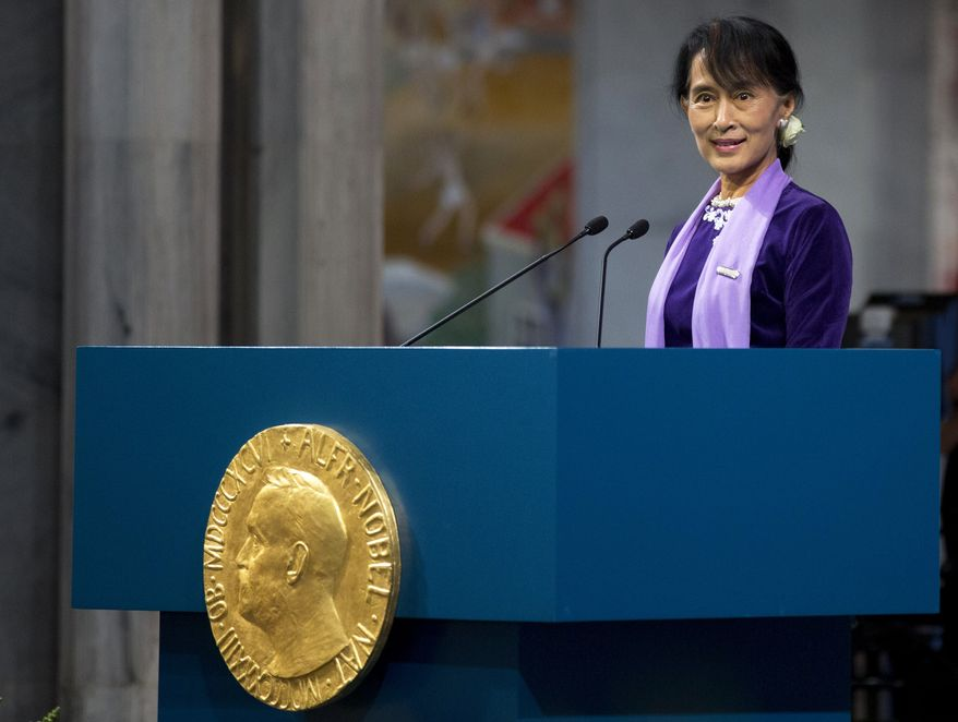 """Aung San Suu Kyi delivers a speech during the Nobel ceremony at Oslo's City Hall, Norway, June 16, 2012. Aung San Suu Kyi said today that winning the 1991 Nobel Peace Prize while under house arrest """"opened up a door in my heart,"""" and helped to shatter her sense of isolation and ensured that the world would demand democracy in her military-controlled homeland. (AP Photo/Daniel Sannum Lauten/POOL)"""