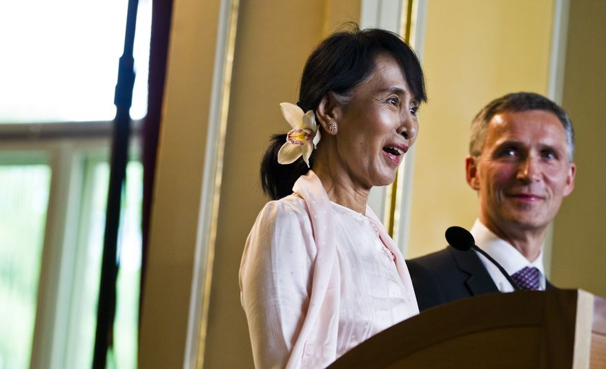 Myanmar opposition leader Aung San Suu Kyi at a press conference with Norwegian prime minister Jens Stoltenberg in Oslo, Friday, June 15, 2012. Suu Kyi formally accepts the Nobel Peace Prize on Saturday June 16, 2012, in the Norwegian capital. (AP Photo / Vegard Groett / NTB scanpix)