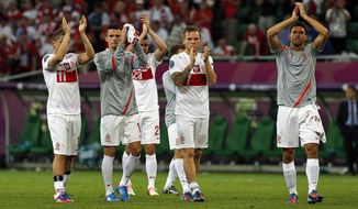 The Polish team acknowledges the crowd after losing to Czech Republic and being ousted from Euro 2012 in Wroclaw, Poland, on Saturday, June 16, 2012. (AP Photo/Czarek Sokolowski)