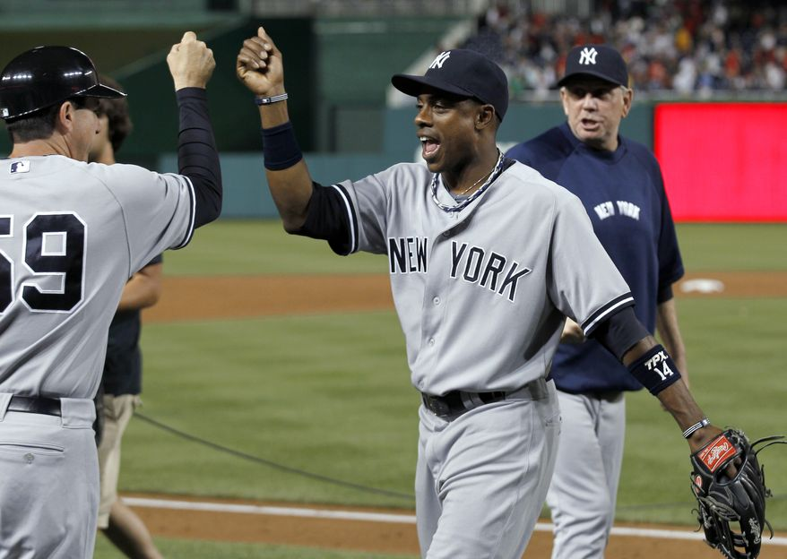New York Yankees center fielder Curtis Granderson went 2-for-5 with a home run and three RBI in his team's 7-2 win over the Washington Nationals on Friday night. (AP Photo/Alex Brandon)
