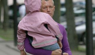 In this June 2009 photo, Drasius Kedys is shown with daughter Deimante Kedys in Lithuania. Kedys claimed his daughter was being abused by a pedophile ring involving the girl's mother and including judges and politicians he claimed preyed on his daughter, who was 5 at the time. He was found dead under mysterious circumstances less than a year later. (Associated Press)