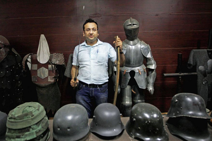 New Delhi businessman Ashok Rai displays helmets from different periods and a body armor at his workshop in Sahibabad, India. From Hollywood war movies to Japanese samurai films to battle re-enactments across Europe, Mr. Rai is one of the world's go-to men for historic weapons and battle attire. (Associated Press)