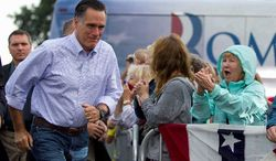 Republican presidential hopeful Mitt Romney arrives for a campaign stop at Mapleside Farms on Sunday in Brunswick, Ohio. No Republican ever has won the White House without winning the Buckeye State. (Associated Press)
