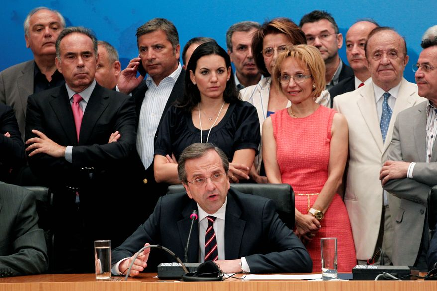 Antonis Samaras, speaking at a press conference on Sunday, leads the New Democracy conservative party, which came in first in Greece's national election. Mr. Samaras has proposed forming a pro-euro coalition government with his party's historic rival, the center-left party Pasok. (Associated Press)