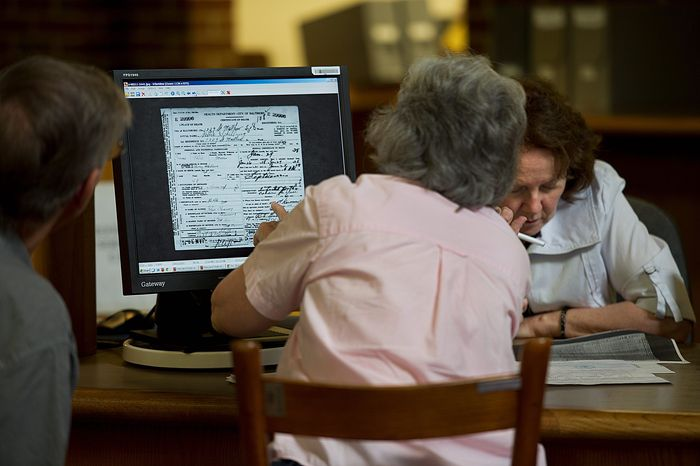 Vickie Allan (right), an archivist at the Maryland State Archives in Annapolis, helps a woman look up information about her husband's family at the facility on Rowe Boulevard. This building opened in 1986, and by 2000 it was filled to capacity. The state rents three warehouses to accommodate archived materials and needs more. (Barbara L. Salisbury/The Washington Times)