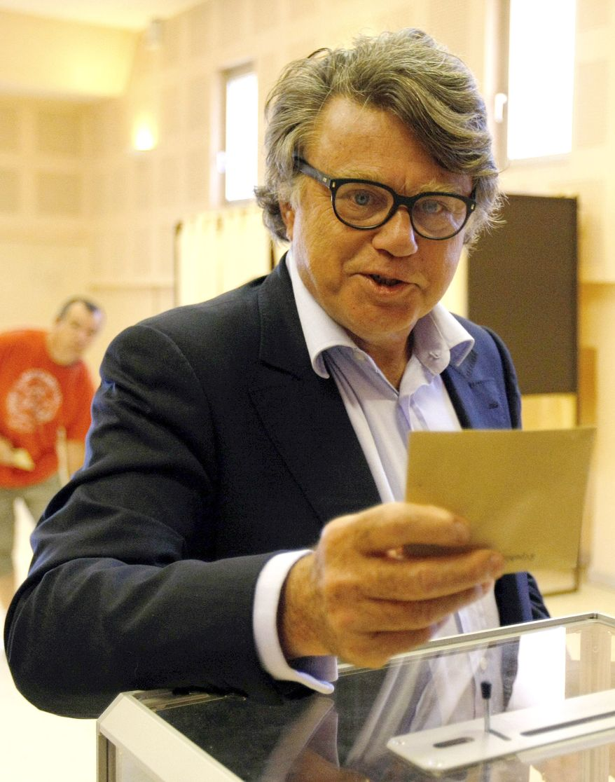 Gilbert Collard, a National Front candidate for France's National Assembly, casts his vote during the second round of parliamentary elections in Gallician, near Nimes, France, on Sunday, June 17, 2012. (AP Photo/Claude Paris)