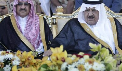 Saudi Crown Prince Nayef bin Abdul-Aziz (right) and his son Prince Mohammed bin Nayef attend a ceremony of the Saudi armed forces on Tuesday, Nov. 1, 2011, in Arafat, Saudi Arabia, near Mecca, as the forces prepare for the influx of people for the annual Hajj. (AP Photo/Hassan Ammar)