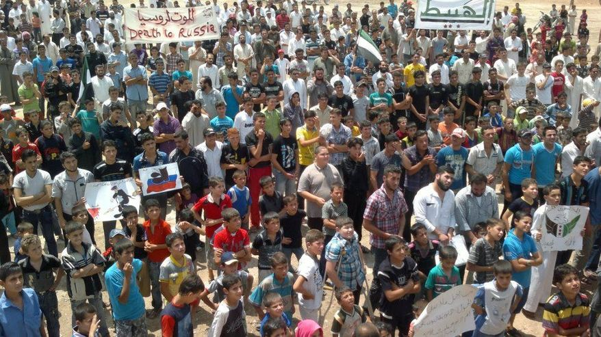 Syrians chant slogans during a demonstration in Idlib province in northern Syria in this image taken by a citizen journalist on Friday, June 15, 2012, and provided by Edlib News Network. (AP Photo/Edlib News Network)