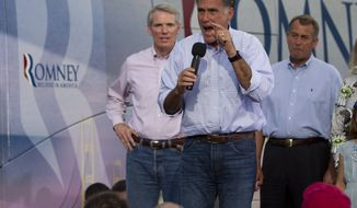 ** FILE ** Republican presidential candidate Mitt Romney speaks on Sunday, June 17, 2012, at a campaign event at K's Hamburger Shop in Troy, Ohio. Joining him onstage is Sen. Rob Portman (left), Ohio Republican, and House Speaker John A. Boehner, Ohio Republican. (Associated Press)